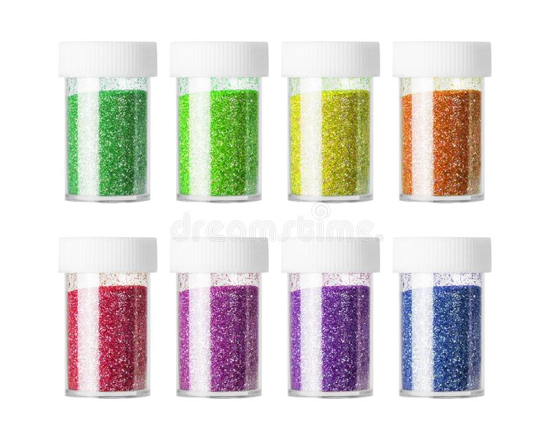 五颜六色在白色背景隔绝的闪烁瓶 构成或装饰的时尚粉末 免版税库存照片