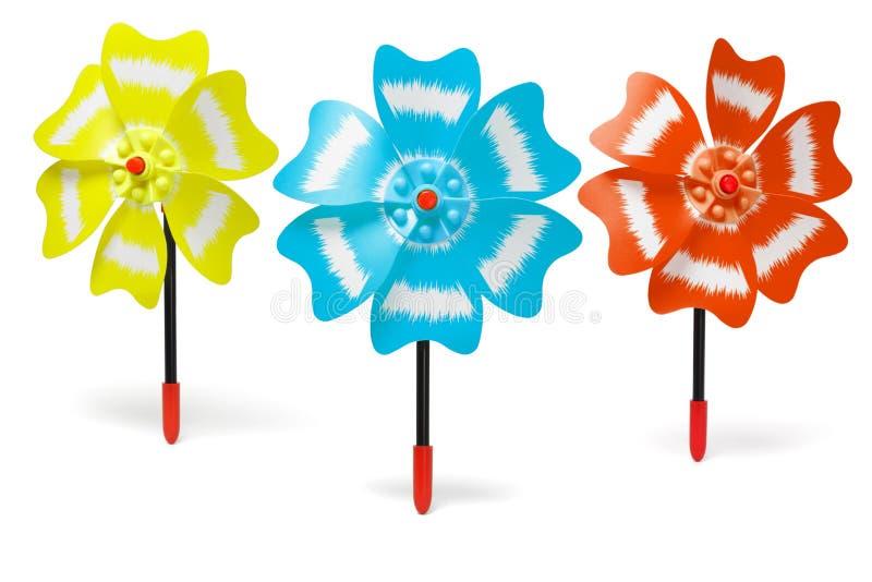 五颜六色的三台玩具风车 皇族释放例证