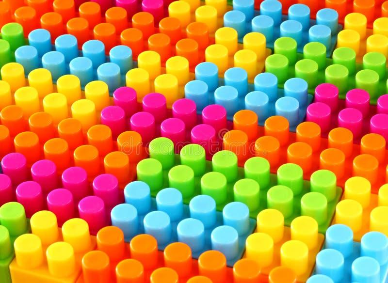 五颜六色的儿童lego砖玩具背景 图库摄影