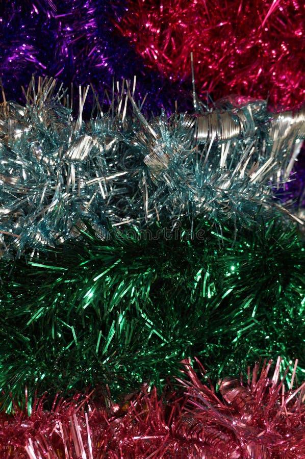 五颜六色的发光的圣诞节闪亮金属片背景宏指令 库存图片