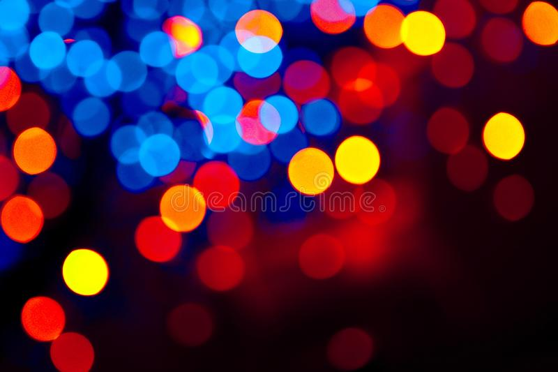 五颜六色的圈子bokeh欢乐闪烁黑暗的背景 免版税库存照片