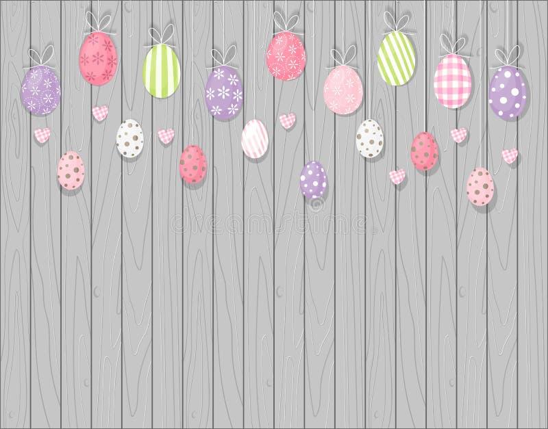 五颜六色的垂悬的复活节彩蛋 背景土气木 动画片样式 免版税库存图片