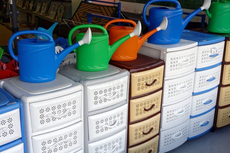 五颜六色的塑料内阁和水罐 库存照片