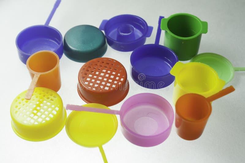 Download 五颜六色的塑料玩具 库存照片. 图片 包括有 空白, 塑料, 蓝色, 玩具, 粉红色, 绿色, 背包, 五颜六色 - 62525032