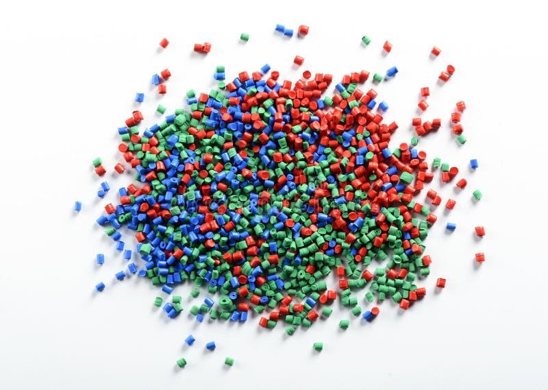 五颜六色的塑料粒子堆  免版税库存图片