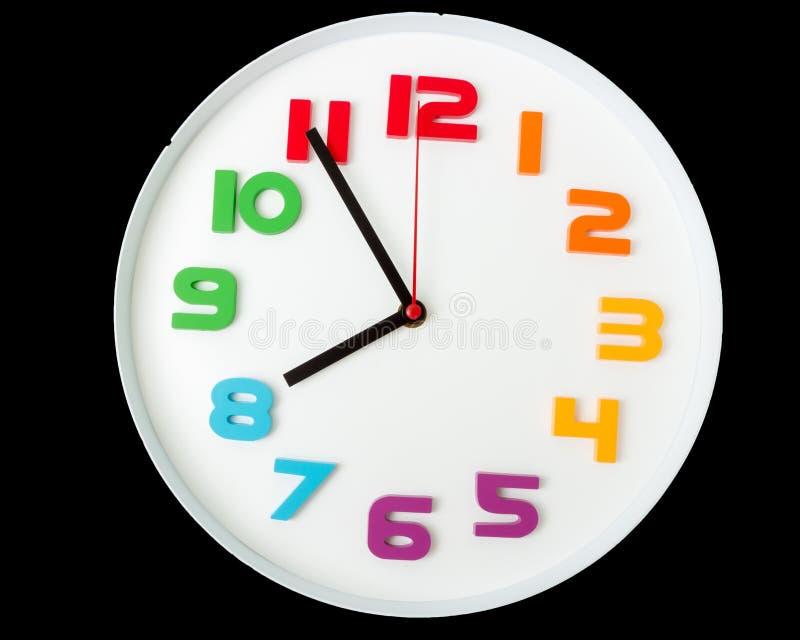 五颜六色的时钟或时间抽象背景 有红色的白色时钟 免版税库存图片