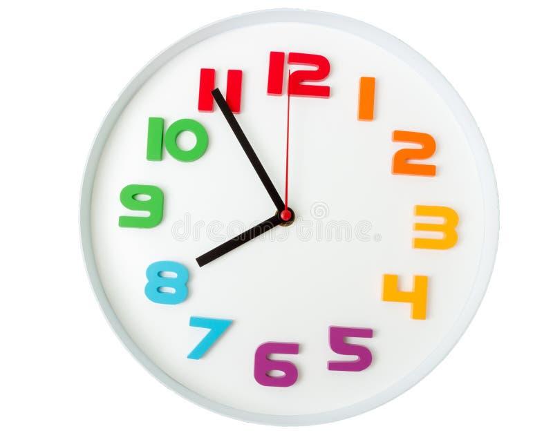 五颜六色的时钟或时间抽象背景 有红色的白色时钟 免版税图库摄影