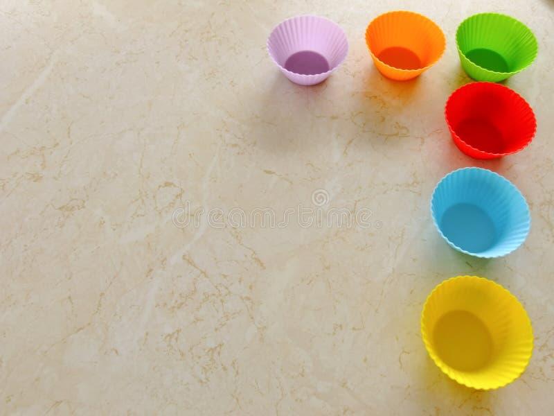 五颜六色的松饼形式 免版税库存照片
