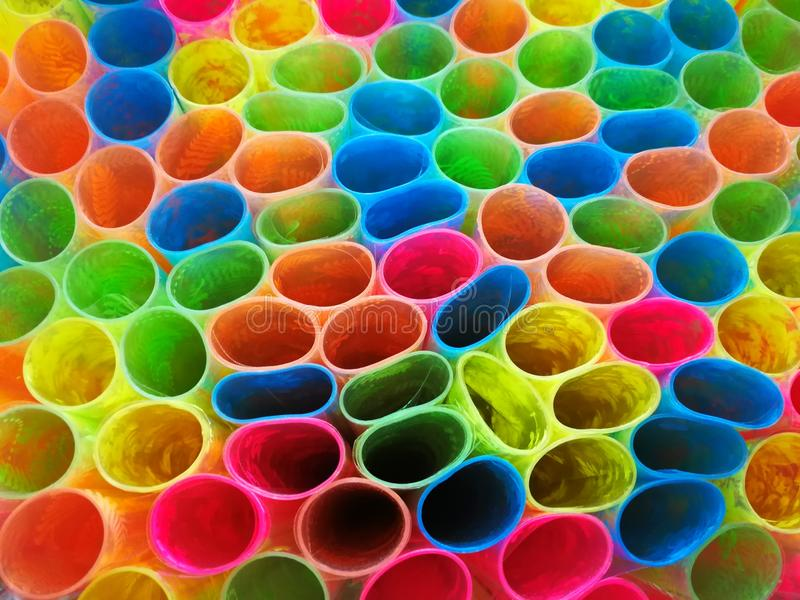五颜六色的样式塑料包裹的书 图库摄影