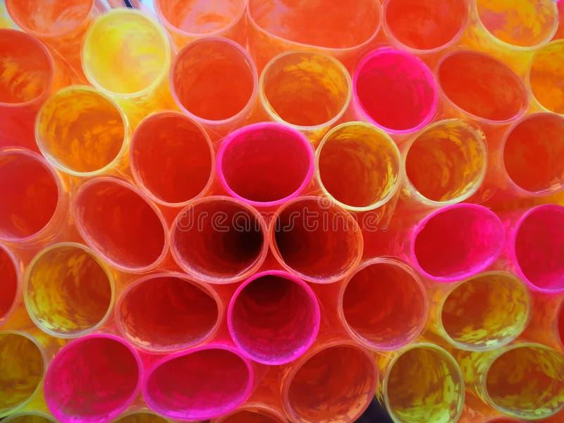 五颜六色的样式塑料包裹的书 免版税库存照片