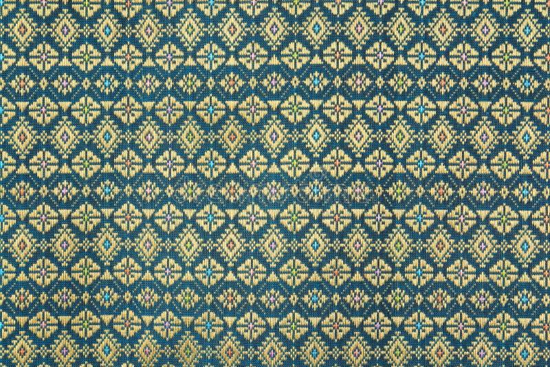 五颜六色的泰国丝绸手工造秘鲁样式地毯表面关闭  免版税库存照片