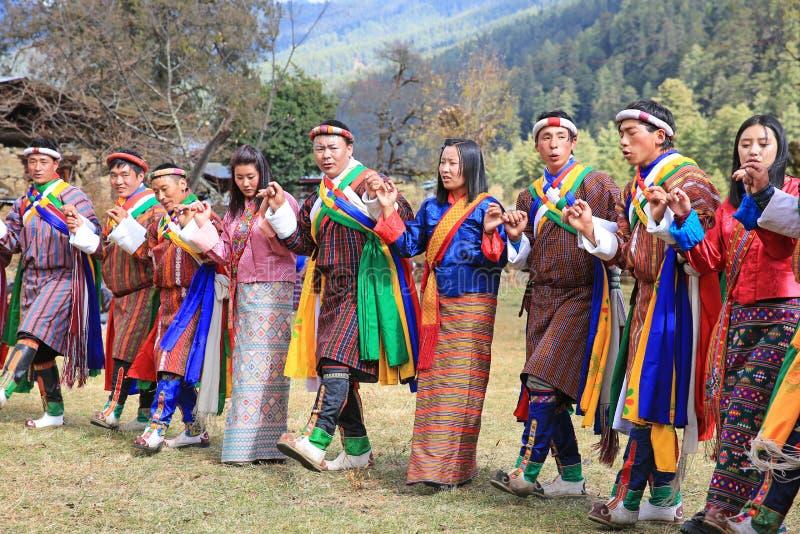 五颜六色的男性和女性牦牛节日参加者,不丹 库存图片