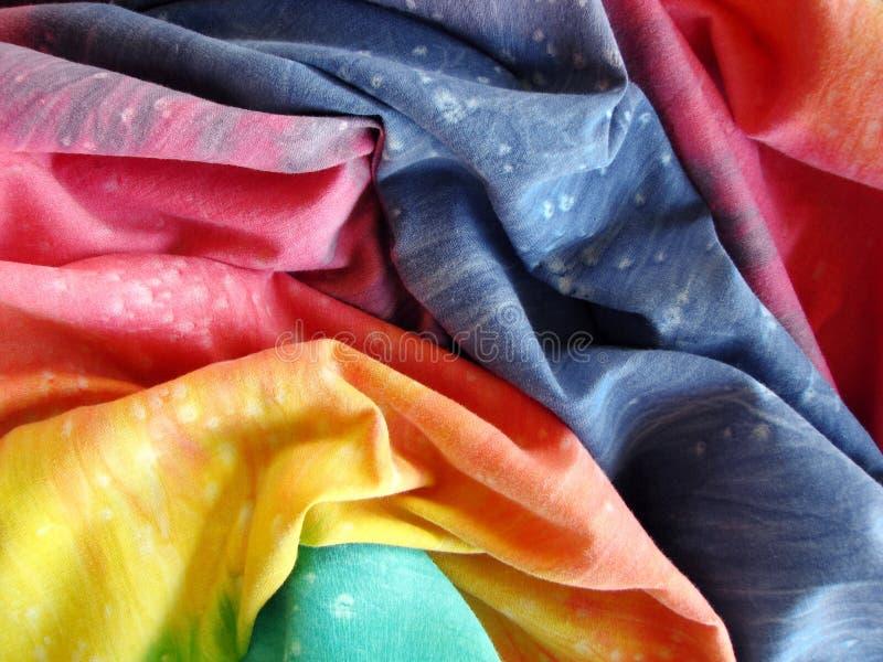 五颜六色的被洗染的织品关系 免版税库存照片