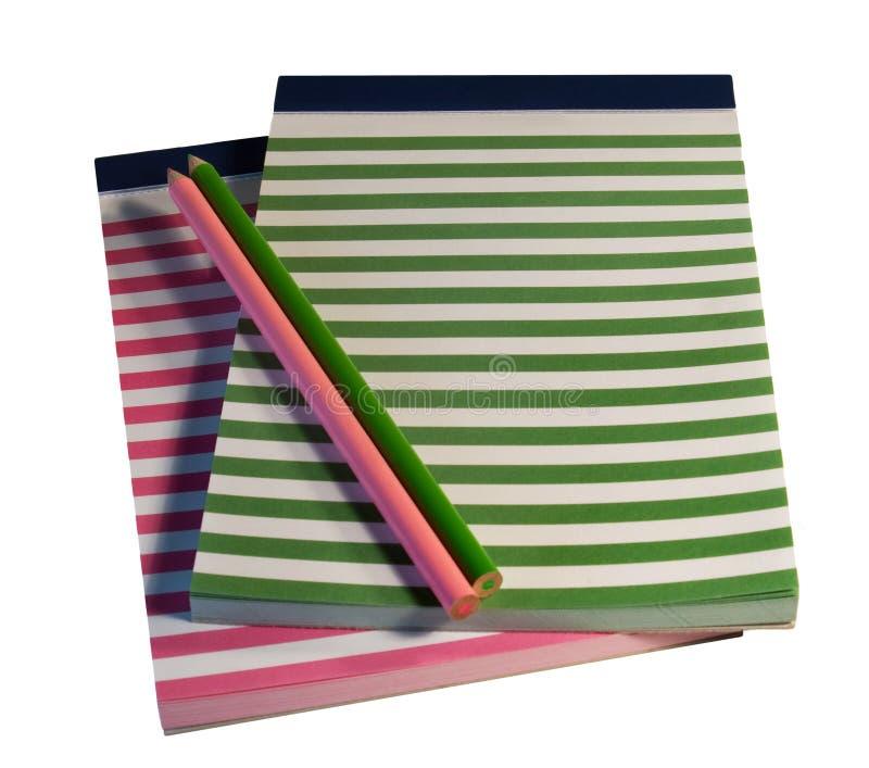 五颜六色的记事本铅笔镶边了 库存图片