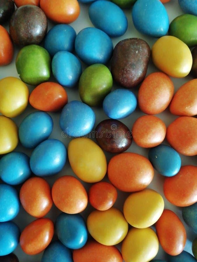 五颜六色的软心豆粒糖为另外设计的背景使用 免版税图库摄影