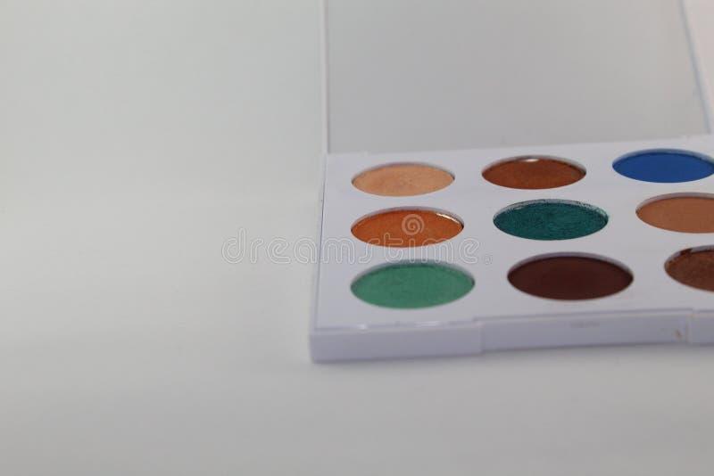 五颜六色组成在有九水彩的一个白色调色板 库存照片