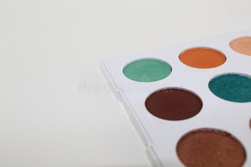 五颜六色组成在有九水彩的一个白色调色板 图库摄影