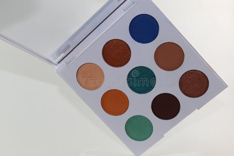 五颜六色组成在有九水彩的一个白色调色板 库存图片
