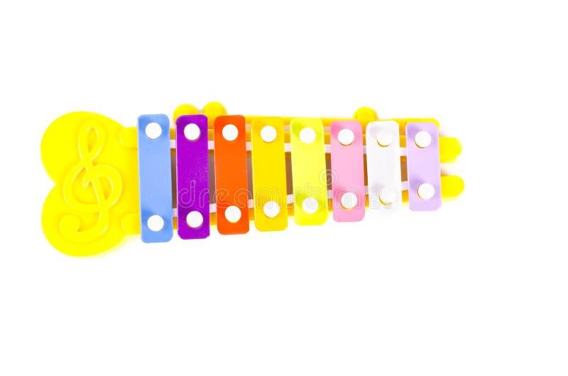 五颜六色8定调子玩具由金属和塑料做的木琴铁琴在白色背景 免版税图库摄影