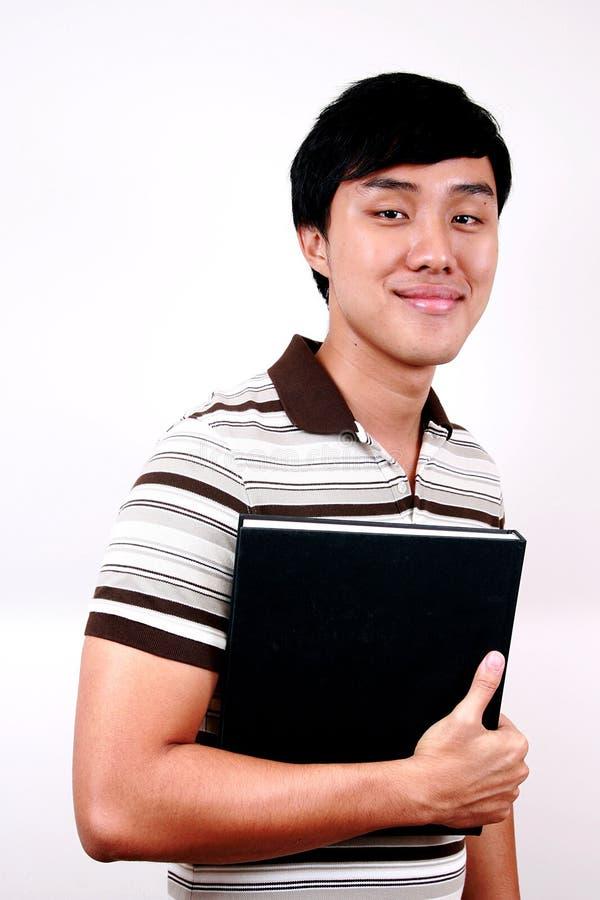 亚洲书现有量学员年轻人 库存图片