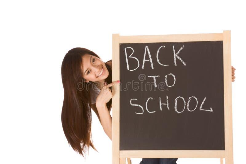 亚洲人回到黑板女性学校学员 图库摄影