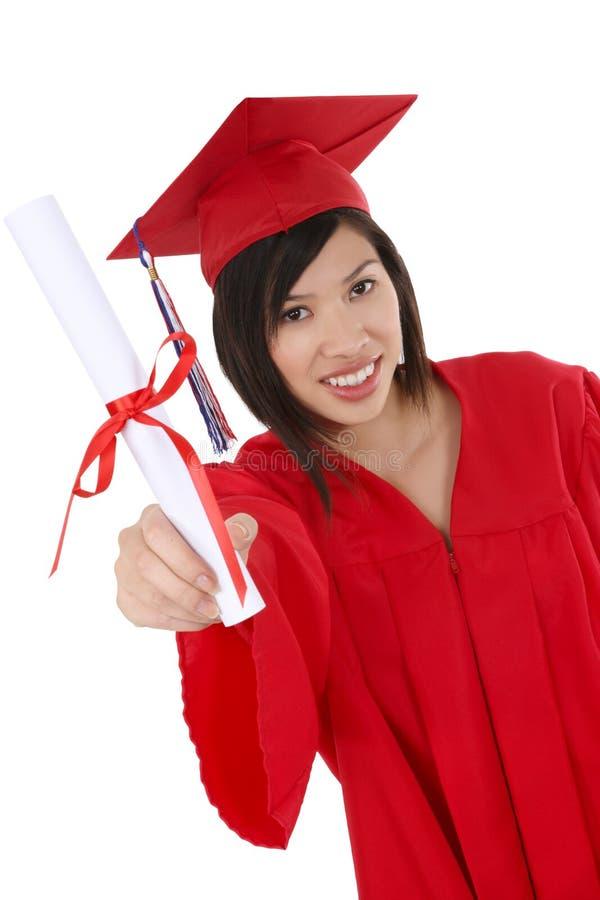 亚洲人毕业生俏丽的妇女 免版税库存照片