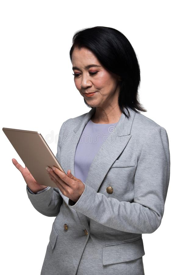 亚洲人50s 60s岁女商人立场衣服 图库摄影