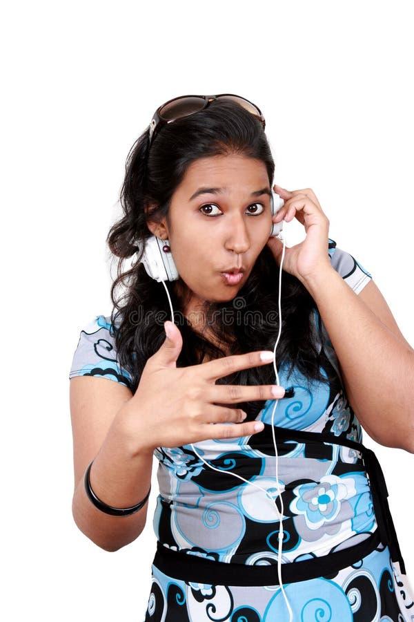 亚洲听的音乐studen对年轻人 库存图片