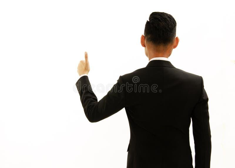 亚洲商人后侧方左手巨大姿态  对展示 免版税库存照片