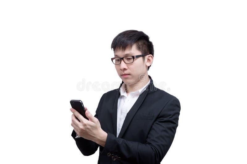 亚洲商人有拿着的一个电话与微笑一起使用和 免版税图库摄影