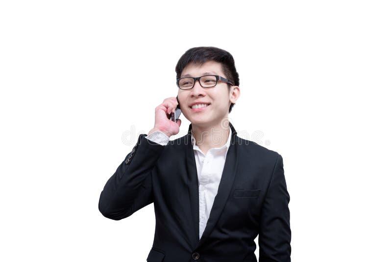 亚洲商人有拿着谈话的一个电话与微笑和 免版税库存照片