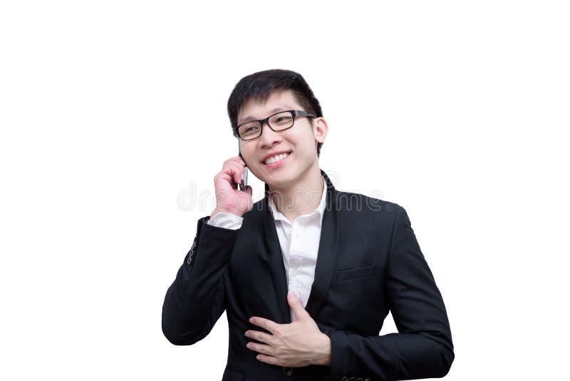 亚洲商人有拿着谈话的一个电话与微笑和 库存照片
