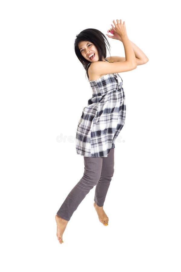 亚洲喜悦跳的年轻人 免版税库存图片