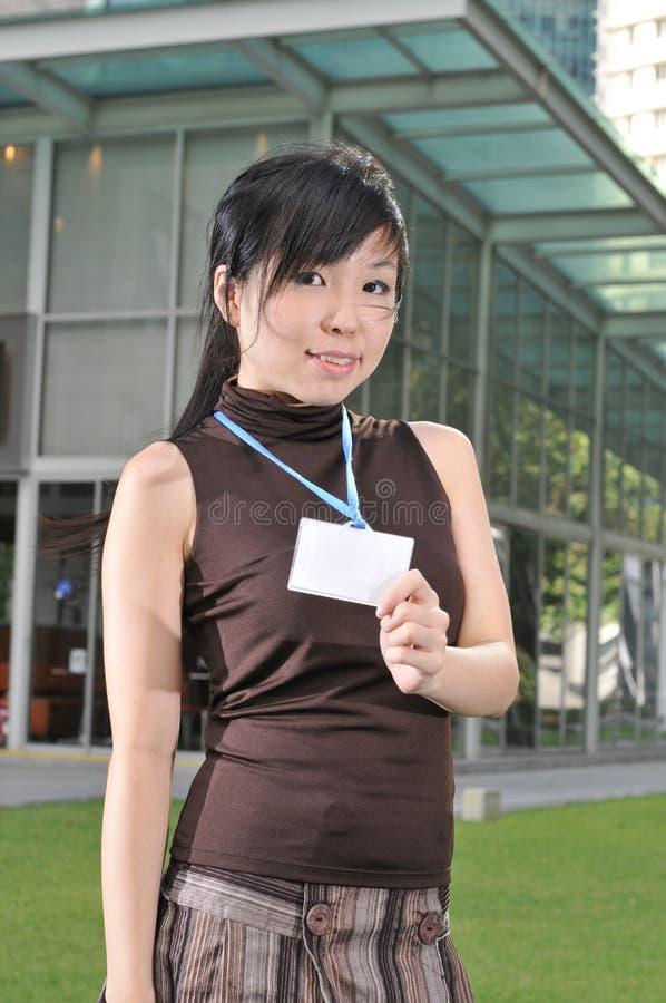亚洲城市她的显示妇女的通过 库存照片