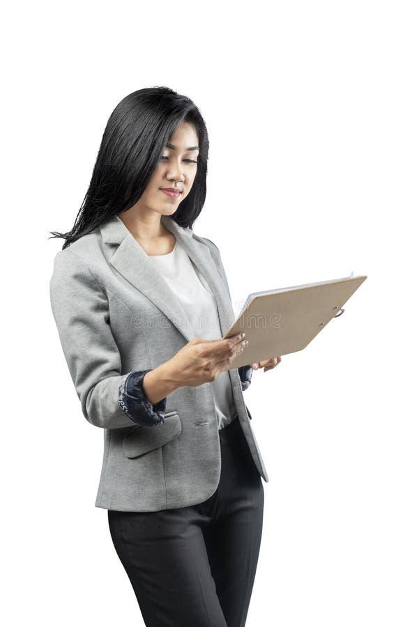 亚洲女商人藏品剪贴板画象  免版税库存图片