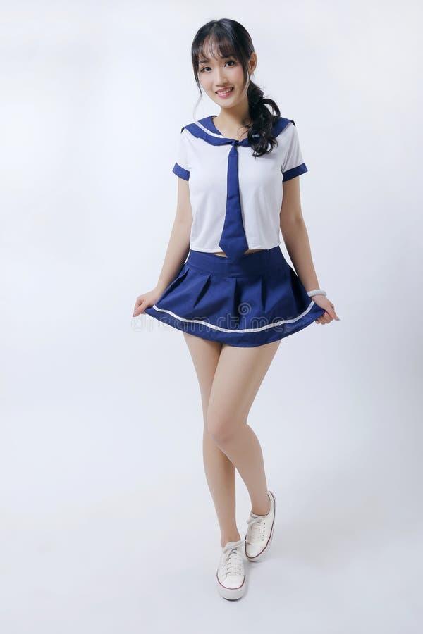 亚洲女孩和水手服 免版税库存图片