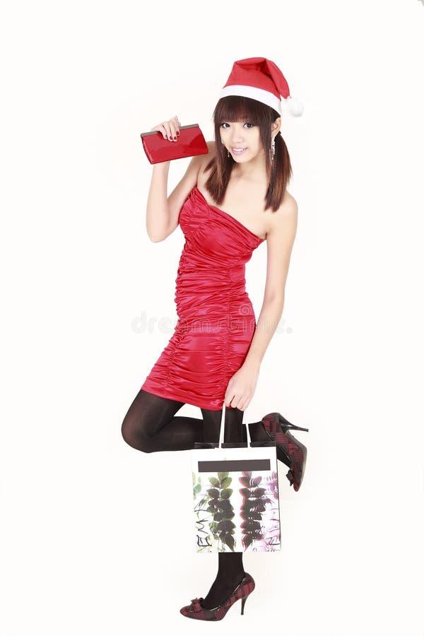 亚洲女孩圣诞老人购物 库存照片