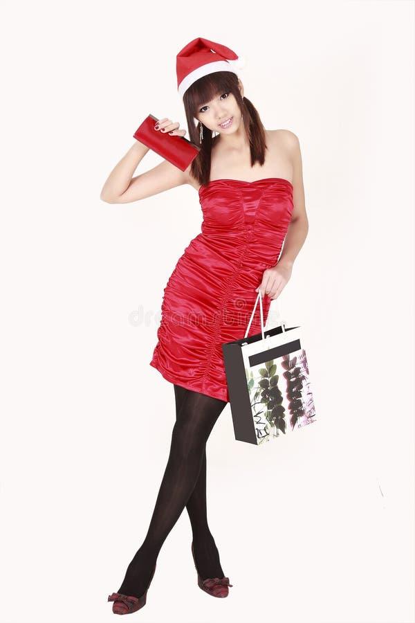 亚洲女孩圣诞老人购物 图库摄影