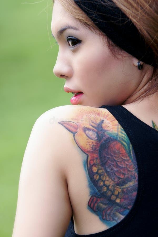 亚洲女孩纹身花刺 库存照片