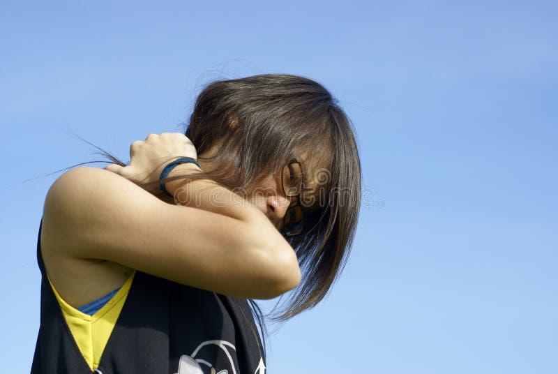 亚洲女孩脖子痛处 免版税图库摄影