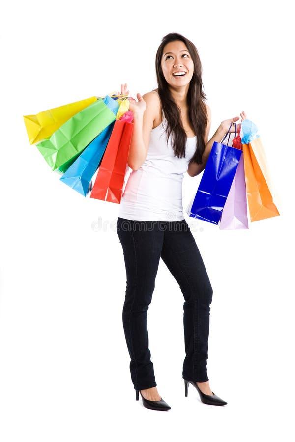 亚洲女孩购物 免版税库存图片