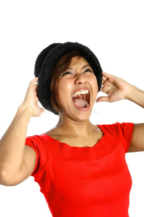 亚洲女性尖叫的年轻人 库存照片