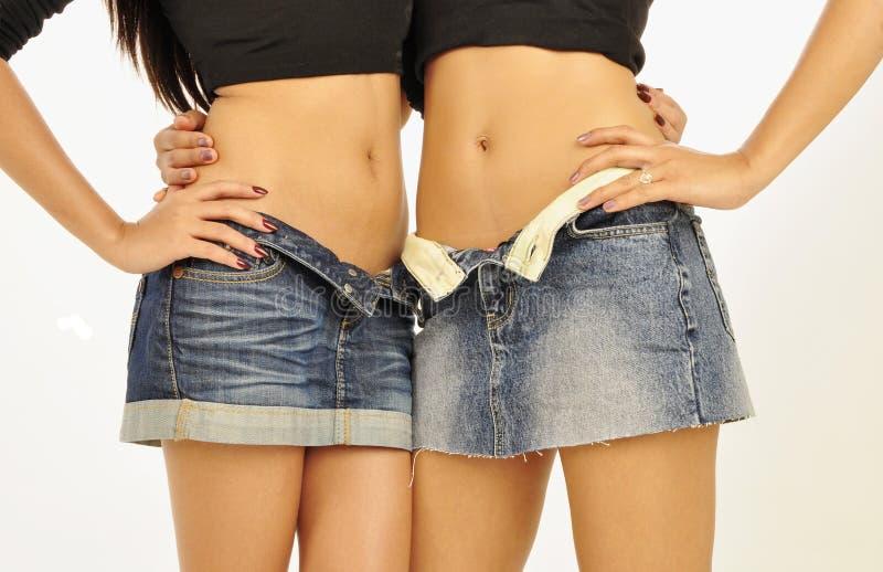 亚洲女性短裙佩带 库存照片