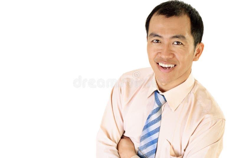亚洲生意人愉快的微笑 免版税库存照片