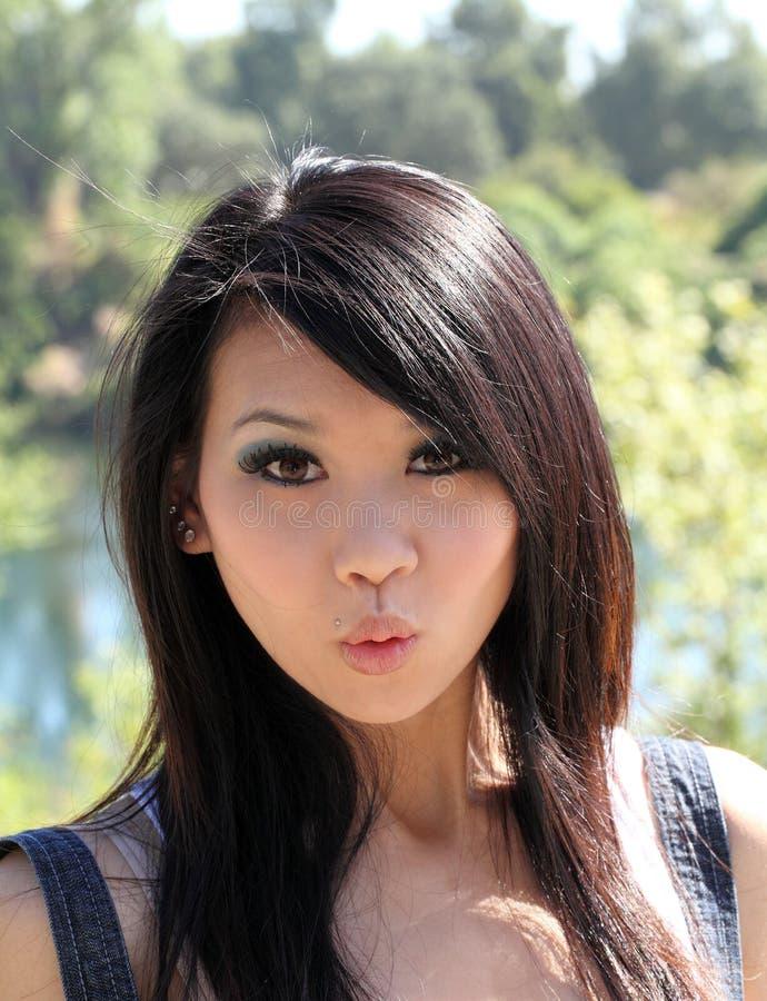 亚洲看起来surpised妇女年轻人 图库摄影