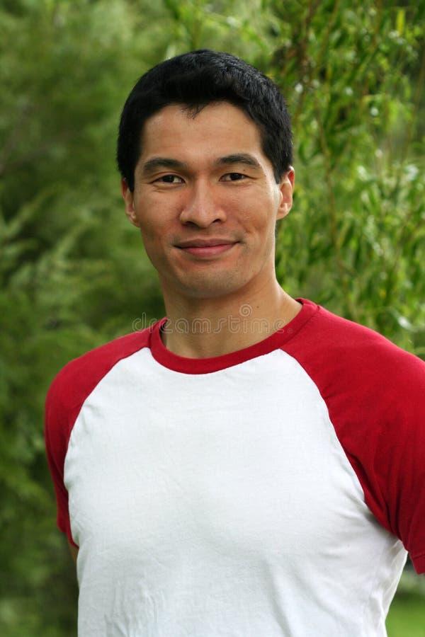 亚洲确信的英俊的男 库存照片
