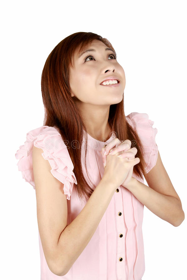 亚洲祈祷的妇女年轻人 免版税库存图片