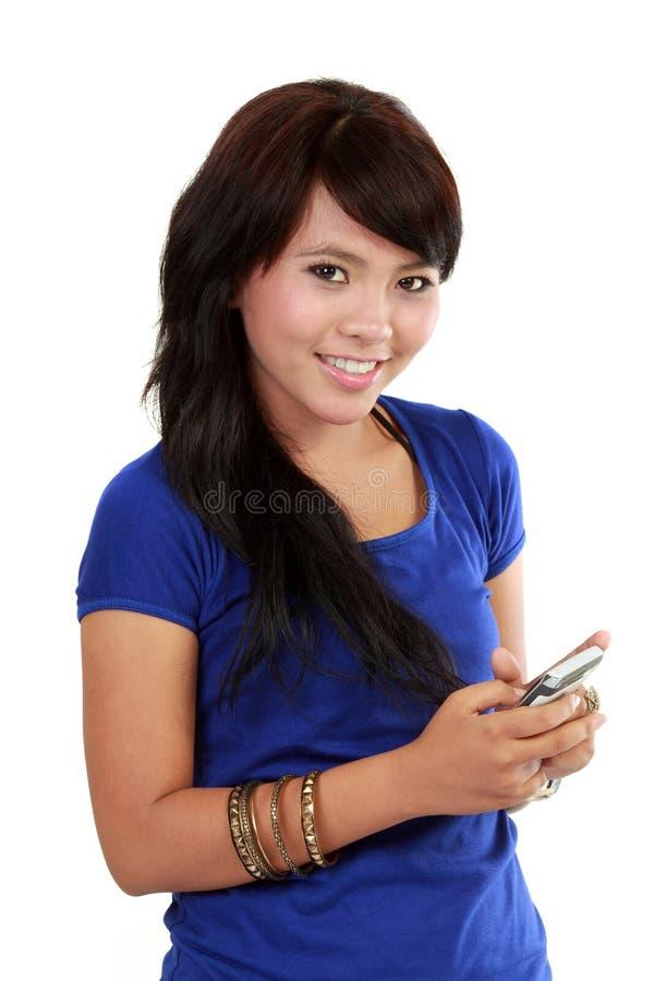 亚洲移动电话她的文本妇女 库存图片