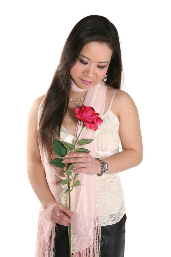 亚洲红色玫瑰色妇女 免版税库存照片