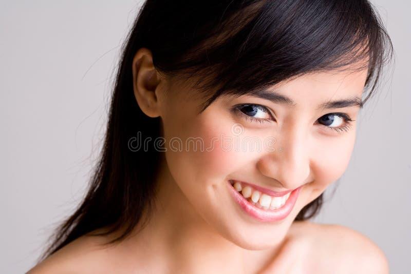 亚洲美丽的眼睛微笑的妇女 库存照片